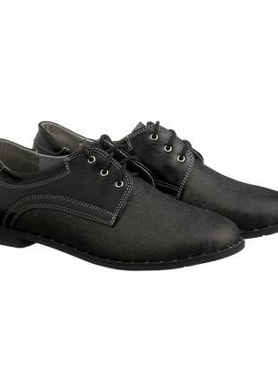 Туфли на низком каблуке со шнуровкой