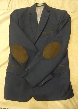 Пиджак синий,длина рукава 50см,от плеча к низу 58,обем 80