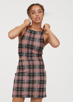 Короткая трикотажная юбка, 36р (s), вискоза 44%; полиэстер 35%; эластан 7%.