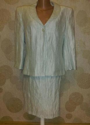 Красивый костюм из жатой ткани лен в составе пог 49,пот 37