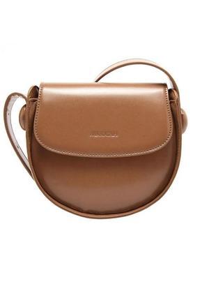 Классная круглая коричневая, бежевая сумка необычной формы на плечо, на длинном ремешке