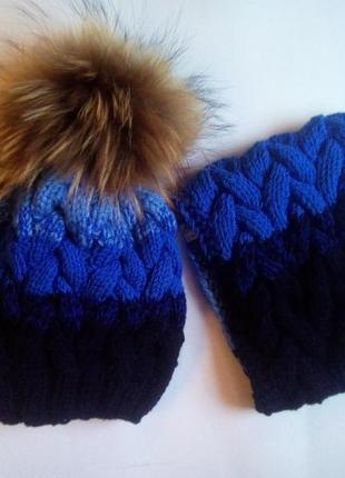 Комплект зимняя шапка + шарф с косами и натуральным помпоном из енота