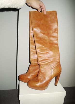 Рыжие сапоги из мягчайшей кожи . высокий каблук .carlo pazolini