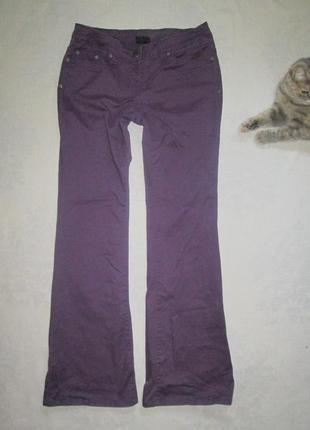 Фиолетовые джинсы клеш