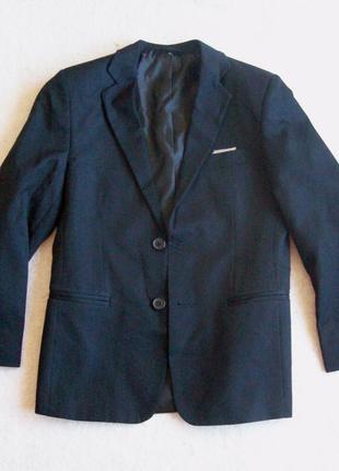 Пиджак черный, длина 59 см.
