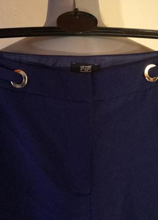 Зауженные к низу брюки с люверсами,42-44 размер2