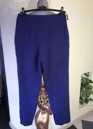 Зауженные к низу брюки с люверсами,42-44 размер3