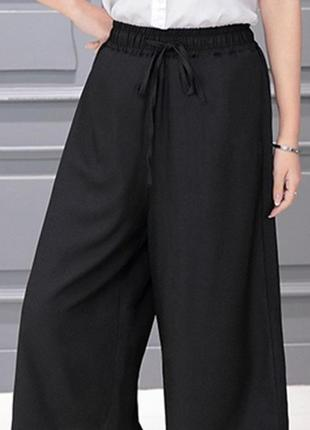 Шикарные летние широкие брюки на резинке с удобными карманами эм/эл размер