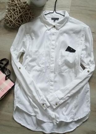 Белая рубаха свободного кроя