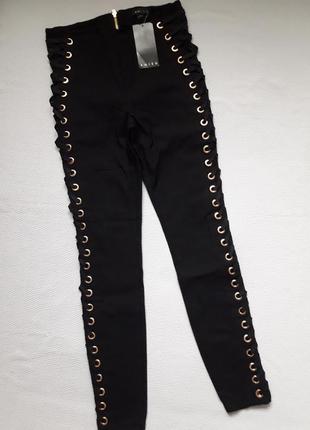 Суперовые стрейчевые брюки со шнуровкой сбоку высокая посадка amisu1 фото