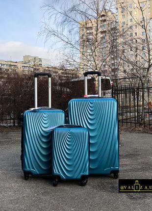 Комплект чемоданов из поликарбоната : большой, средний, малый пластикова валіза