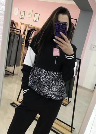 Трендовий чорний костюм із леопардовими вставками, італія