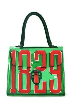 Необычная зеленая силиконовая сумка с красным принтом. тренд