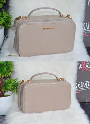 Фирменная сумка из экокожи david jones с брендированной фурнитурой