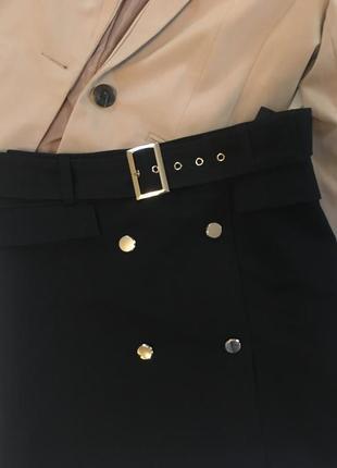 Новая чёрная юбка  трапеция с пуговицами на запах