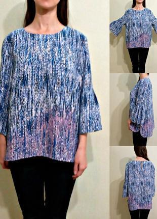 Красивейшя блуза свободного кроя с воланами на рукавах