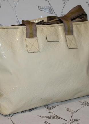 Большущая кожаная сумка gucci серийный номер
