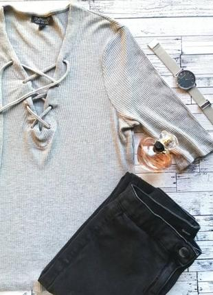 Кофточка серая от топ шоп с завязками в рубчик.