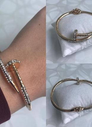 Женский металлический браслет гвоздь с камнями золотистый
