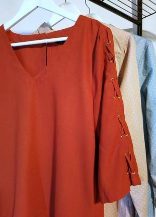Женская блуза со шнуровкой