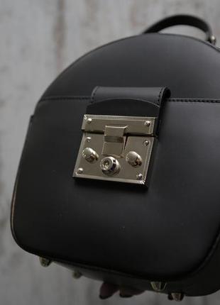 Круглая кожаная сумка с италии