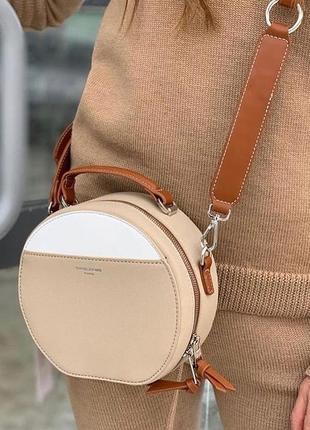 Новая бежевая круглая женская сумка клатч