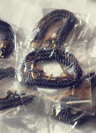 Синий плетеный браслет с якорем