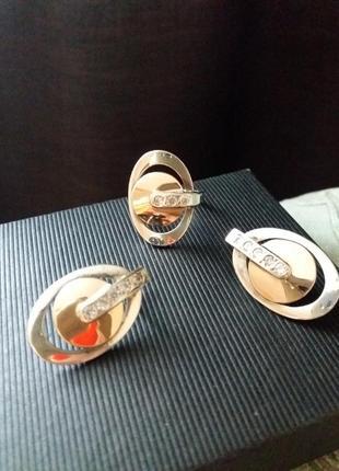 Серебряное кольцо и серьги.