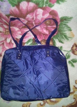 Фиолетовая стеганая сумка avon