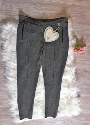 Фирменные зауженные брюки/лосины с отделкой