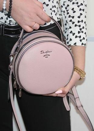 Круглая, оригинальная и супер стильная сумочка david jones.