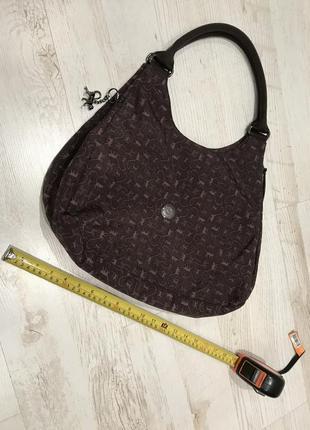 Многофункциональная сумка kipling с тремя отделениями и с внутренними карманами