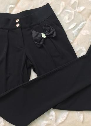 Новые стильные модние красивые черние брюки из италии