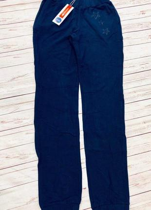 1. синие спортивные штаны для девочки1 фото