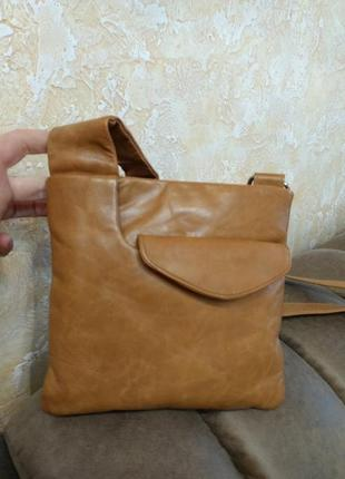 Симпатичная кожаная сумка taurus