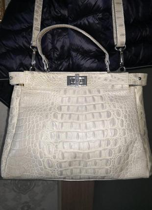 Красивая кожаная сумка genuine leather