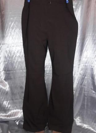 Трендовые коричневые штаны клеш от колена