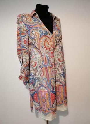 Удлиненная блуза с карманами и красивым ярким принтом