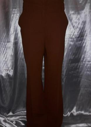 Трендовые рыжие брюки-трубы