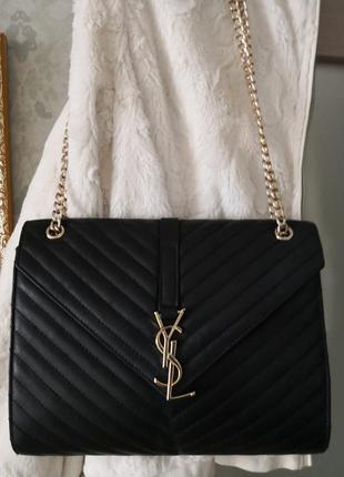 Роскошная кожаная сумочка.