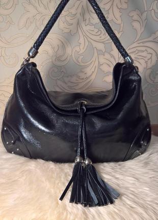 Кожаная лаковая сумка.