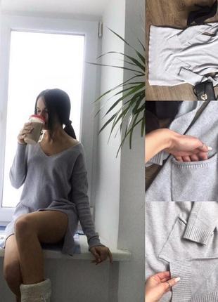 Тепленьке сіре плаття з кишенями і розрізами по боках