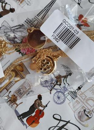 Многослойная цепочка ожерелье с подвесками золотистого цвета4 фото