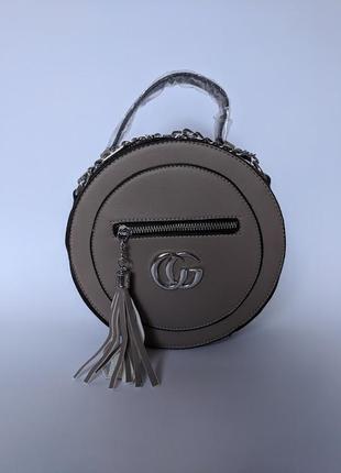 Модная круглая сумка