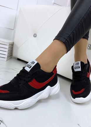 Стильные черно-красные кроссовки на фигурной подошве7 фото