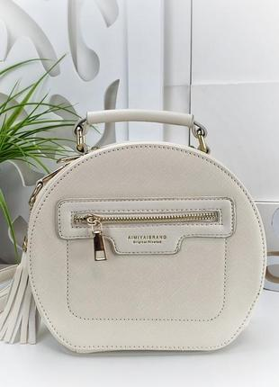 Светло-бежевая  круглая сумочка-клатч, очень стильная и красивая