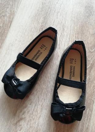 Лакированные черные балетки
