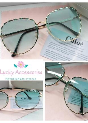 Красивые очки с зелеными линзами