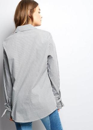 Рубашка в полоску с бантиками на рукавах4 фото