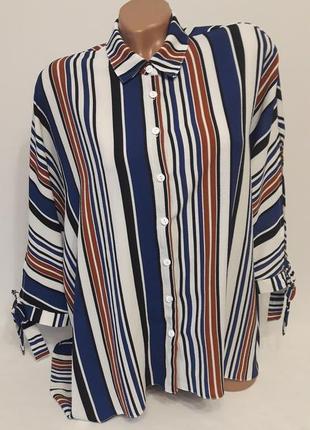 Полосатая рубашка в стиле оверсайз